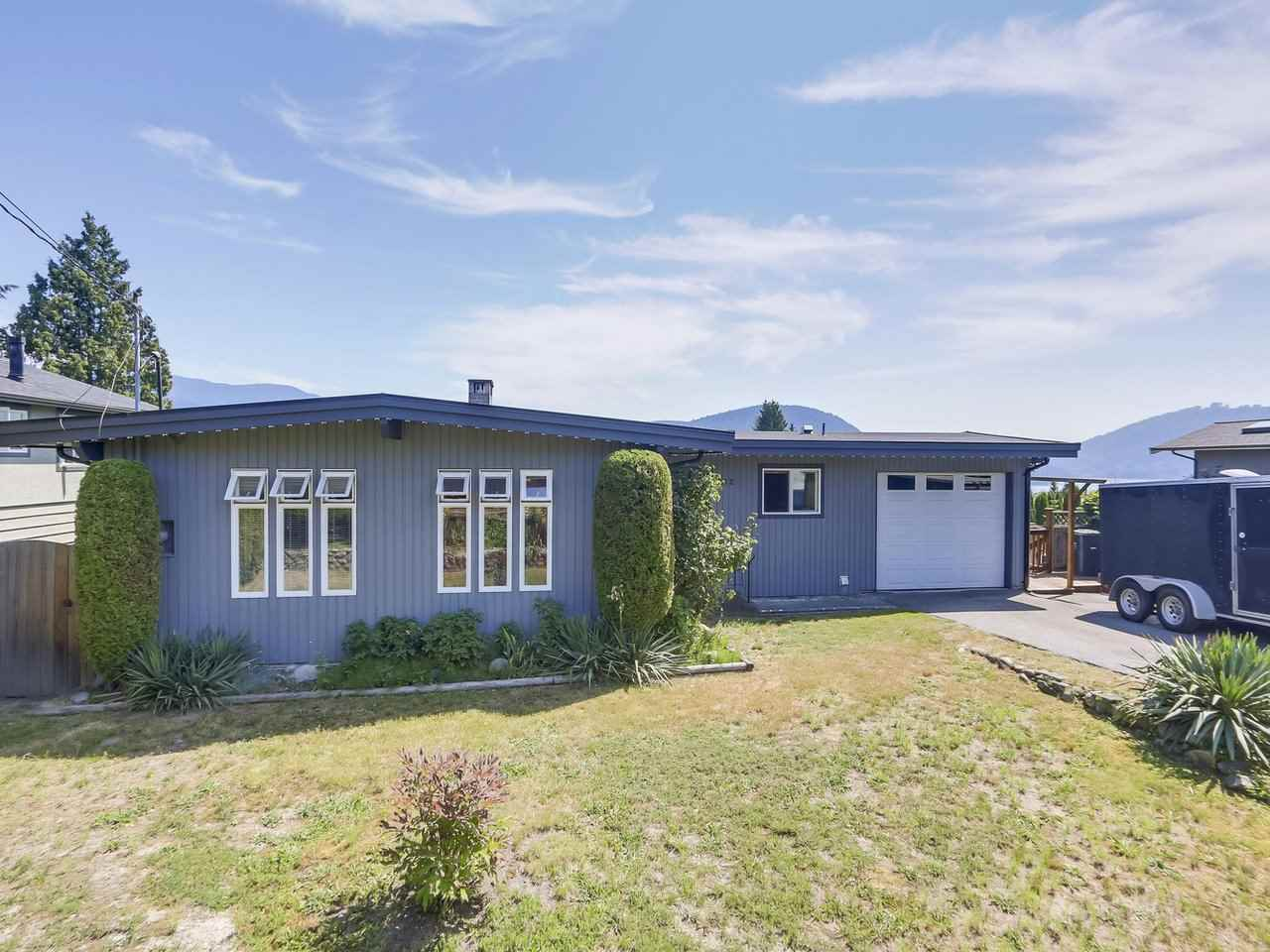 """EXTREMELY well maintained and renovated home on a very quiet street WITH WATER VIEWS of Indian Arm! The backyard is an oasis of privacy! Palm trees thrive here! Nothing to do but move in and enjoy the views! Steps to beaches, great schools, shops, golf courses, skiing.... downtown just a half hour away. A half block away is a great park for kids! No need for """"Jungle Jim's"""" in your backyard!"""