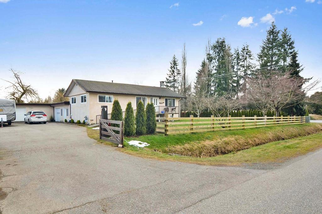 Stratafiable South Langley 3/4 Acre Parcel. RU-3 with ALR exemption This property offers a 2173 square foot farm house in good condition. You can stratify 2 lots - each approximately 100'X152' (15200 sq.ft.) - each lot would front 18th Ave. This is an excellent opportunity for Builders and/or Extended Families. Located on a Premier Street of multimillion dollar homes. Quick access to Langley. A Great Project.