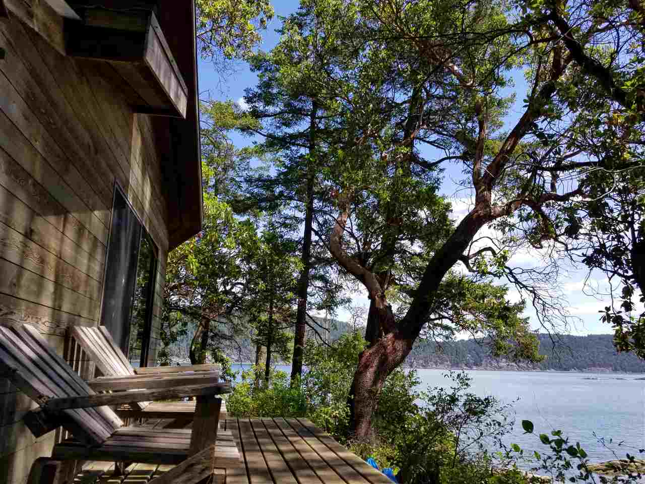 Fine waterfront point property on 0.4 forested acre on Wise Island. Fully useable land. Rare low bank waterfront cabin with a sandy beach in a shallow bay that dries out at low tide. Exquisite panoramic views of Trincomali Channel across to Galiano and eastwards towards Montague Provincial Park with its wonderful shell swimming beaches. Connected to a community water system. Wise Island is located between Galiano and Salt Spring Island and is easily accessible from protected Montague Harbour on Galiano or from Ganges on Salt Spring Island. A wonderful property for families with kids. Go for a swim, circumnavigate Wise Island by kayak or watch the setting summer sun up Trincomali Channel. Rustic cabin is well appointed on the land!
