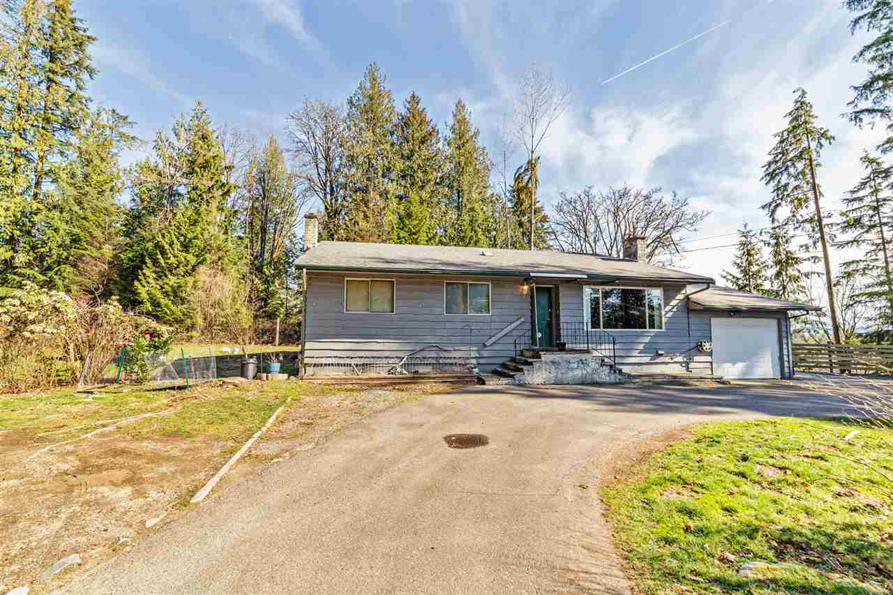 """""""ASSESSED VALUE $875,000"""" GREAT VALUE, GREAT LOCATION, close to golf course and sports park. Large 2 acre property with potential for view if trees removed. Invest in your future, big plans for this area and executive style homes all around. This home has 4 bedrooms plus a games room on the main floor and a total of 2,410 sq.ft. finished area including basement area. Updated carpeting and paint. Outside there is loads of parking for all the toys. See your new home today, before its to late!"""