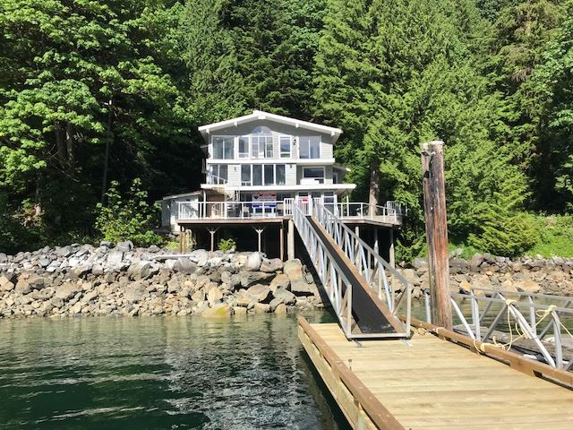 Amazing and extremely rare opportunity to buy 2 Waterfront homes for the price of one on 200 ft of incredible low bank frontage! Beautiful peace and privacy in supreme location with your own private little cove next to park land @ Helga Bay, Indian Arm. This one of a kind enclave is a 20 minute boat ride from Deep Cove and offers stunning ocean/mtn views and sunny South West Exposure. This property would make a fantastic multi family purchase or vacation income opportunity as there are two fully self contained separate dwellings. Bring your fresh ideas and get your creative energy flowing as this property offers many different possibilities.
