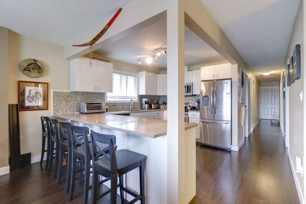 This nice, bright single detached home has lots of upgrade: - big ticket items were upgraded year 2014 - newer kitchen, appliances, windows, window coverings/blinds, bathrooms, bedrooms, spacious walk in closet in  master bedrm, fireplace, new deck, railings, patio cover, 2 in-suite laundry areas. New high efficiency furnace was replaced in November 2017. Roof is 9 years old. Open concept. Authorized 2 bedroom suites is a great mortgage or in-law suite, on ground level. Lots of potential for this long lot .  Easy commute to Vancouver via West Coast Express, Coquitlam Central Station. Close to Kilmer Elementary School. Book your appointment now... don't miss this one.  SHOWINGS: TUESDAY 12- 4PM, AND SUNDAY BETWEEN 2PM - 4PM, BY APPOINTMENT ONLY,  24 HOUR NOTICE.