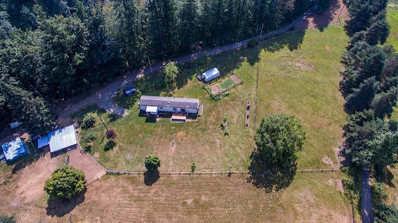 MOTIVATED SELLERS - MAKE YOUR OFFER! The best of both worlds & lifestyle! 9.86 acres of serene country living yet close to Lindell Beach & Cultus Lake. Located at the end of a no thru road, acreage is flat and useable (approx. 2.5 acres of hillside onto Frost Creek), 36' x 20' barn w/ 110 amp service, chicken coop, 16' x 16' tractor shed & storage shed. Manufactured home includes new windows, newer s/s appliances, front loading washer/dryer, pot lights, bright & sunny white eat-in kitchen & large living room w/ new sliding glass door to your deck. Enjoy the peace, tranquilty & sounds of nature this amazing once in a lifetime property has to offer; amazing possiblities & short drive to Garrison Village for all your shopping needs. Check out the video tour YouTube