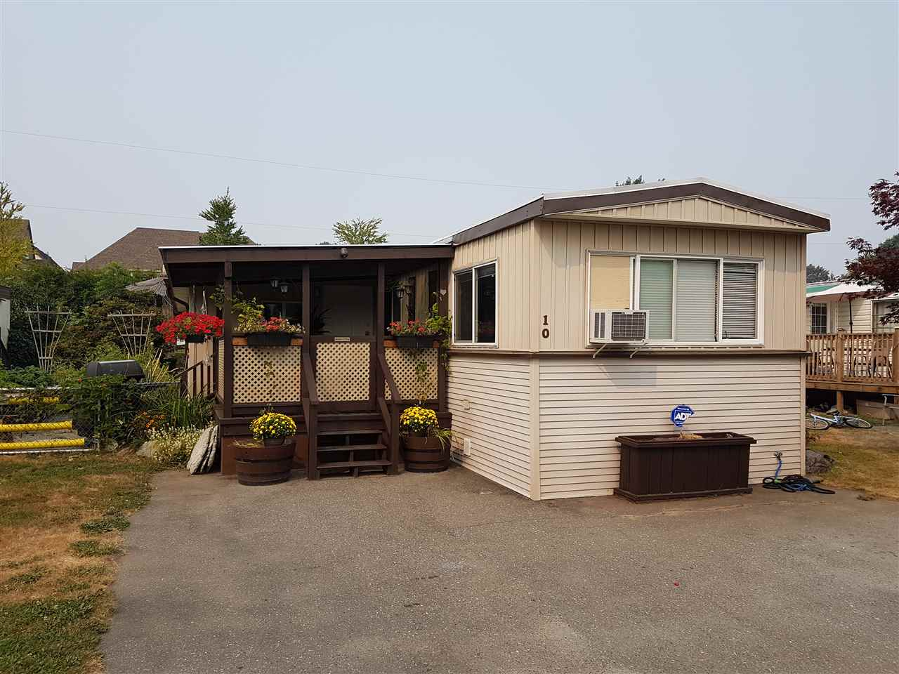 """Come see this well-maintained 3-bedroom, 2-bathroom home with a beautiful yard and rock garden. Open kitchen, large living room, 10'x12' sundeck, and 220V powered shop. Updated electrical and new CSA label. This home could be ideal for a growing young family, or downsize in comfort in this central Sardis location. Westwood Estates is close to shopping, restaurants, transit, schools, Cheam Leisure Centre, and Garrison Crossing. No age restriction, and one small dog (up to 15"""") or cat allowed. Park approval required with references and criminal record check."""