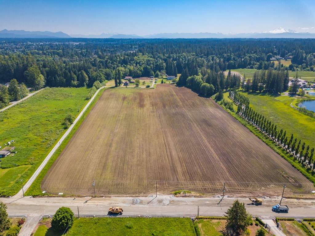 Must be sold in conjunction with 4664 192 St for a total of 40 ACRES see MLS# R2301454. There will be 2 properties of +/- 15 ACRES each. These would be in the ALR & well suited for equestrian purposes & or vineyard or farming. Farm status provides for very low taxes. Build your dream estate in the country but just minutes to all services. There will be 2 more properties of +/- 5 ACRES each. These would offer a very private setting for your dream estate with a creek providing ultimate privacy. Or hold for future development. A great opportunity for the shrewd investor looking for a strong upside with excellent flexibility now. There are currently 2 homes, plus a 3 stall barn with living quarters on the property & these can stay in place until you decide to build. Potential revenue of $8000/mo now. Foreign buyers take note of the farm status. Located in a quickly growing area with a MEGA Estate next door, minutes to the border, a short drive to YVR & easy access to Vancouver. Great land, not in the floor plain.