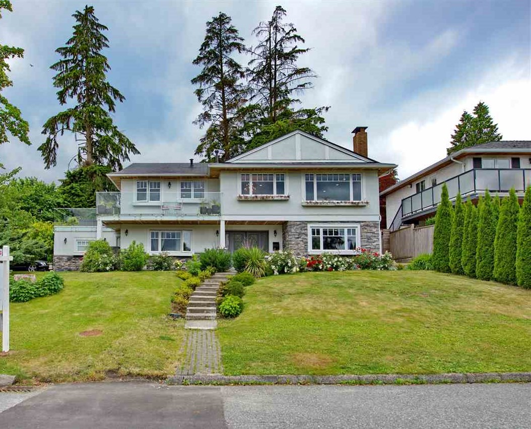 This updated gem, nestled on a beautiful 10,000 sq.ft + lot in front of magnificent water and mountain views, is definitely one of a kind. This elegant home not only features two full size kitchens, but also includes a hot tub, spacious decks and ample parking, perfect for two families or a family with in laws living with them. While the home is situated in the serene neighborhood of Dollarton, you'll be surprised to discover that amenities, schools, Deep Cove and it's trails are only a walking distance away. Don't hesitate too long, because homes like this one won't last long.