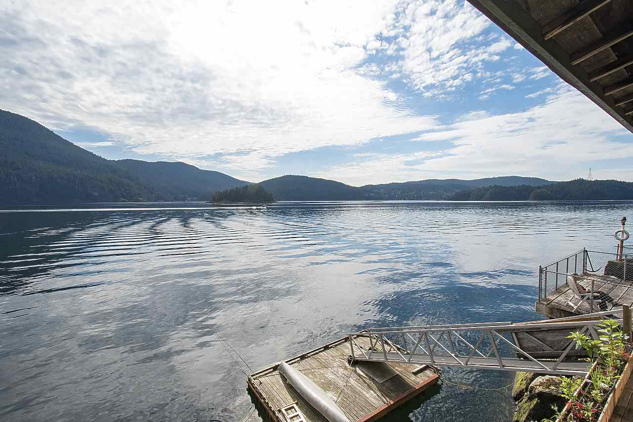 WATERFRONT AT AN AFFORDABLE PRICE IN A PREMIUM LOCATION!! It is very rare to find such an amazing property, with DOCK, in this price point. Large property with home RIGHT ON the water. It feels like you are living on a boat with deep water moorage and views in all directions. Windows everywhere with tons of light, huge decks and patios, and tons of privacy. Two separate suites make getting into this amazing property even easier. Ten minutes to Parkgate Village and under 30 minutes to Vancouver. A very rare gem!