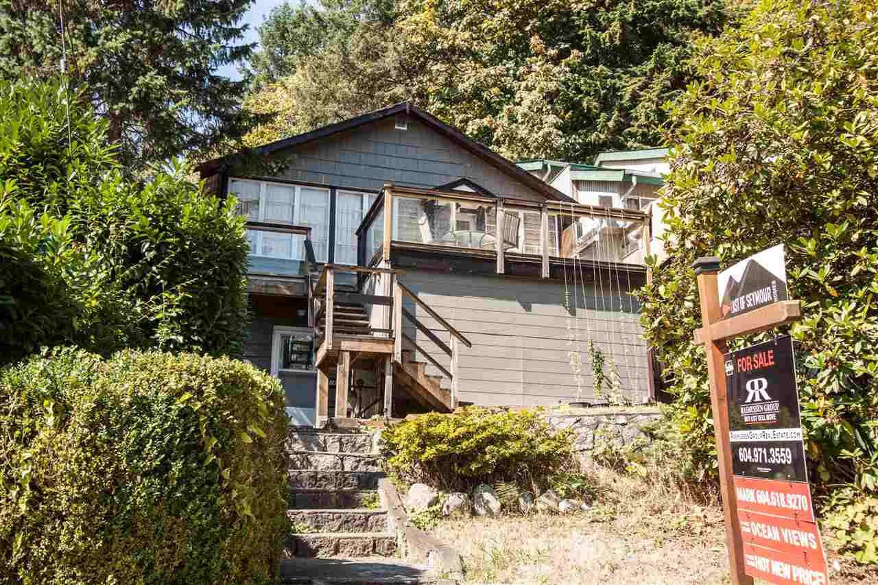 """SEMI-WATERFRONT! Build, Hold or Renovate! Across from Panorama Park right in """"The Cove"""" this cute beach house awaits your updates or build your dream home on this large 9,500+ SF view lot with close-in park, ocean & mountain views! Original cottage was raised and updated mid-60's with new foundation. Steps to the beach, Quarry Rock Hiking Trail, Deep Cove Yacht Club and the quaint Deep Cove Village with its multitude of famous coffee shops, shopping, theatre & fine dining. Sunny location on one of Deep Cove's most sought after streets. Very easy to show!"""