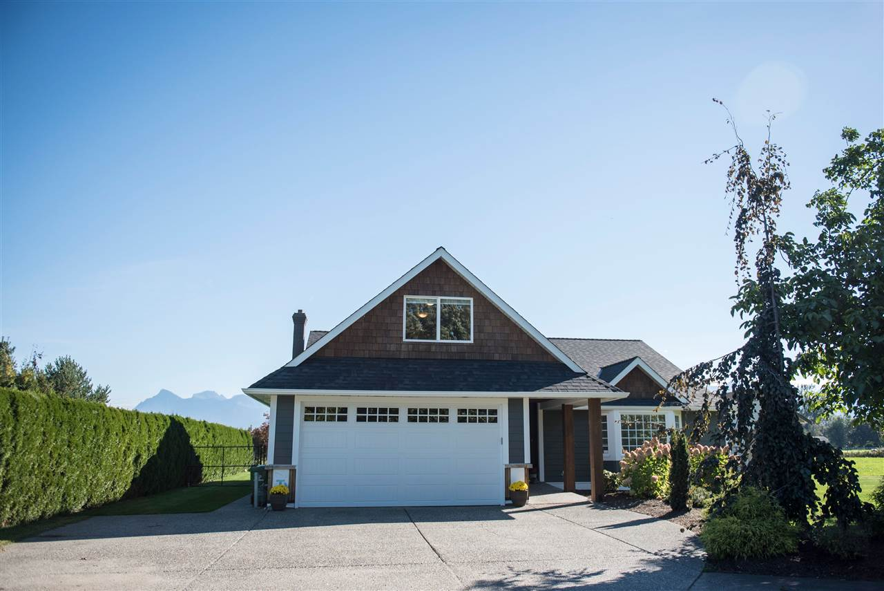 Spectacular updated home on 19.79 acres! Check out this substantially renovated 1617 sqft. 4 bedroom rancher! Updated kitchen with siltstone counters, new hardwood floors, & an amazing post & beam (vaulted ceiling) covered deck. Unobstructed Mt. Cheam & farmland views. Level, drained 19.79 acres with prime growing soils. Ideal for hops, nursery, vegetable or forage productions. Easy freeway access & close to all amenities. Call for details today!