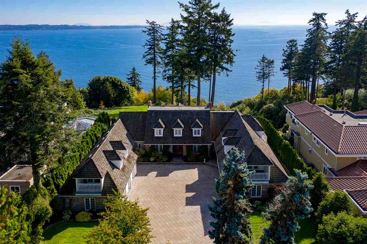 Ocean Bluff Estate !!! 1.62 ACRES White Rock, British Columbia. One of the finest ocean bluff, view properties on the waterfront. Now is the time and opportunity to own this gorgeous, rarely available Marine drive, gated estate property at a very attractive price. Enter thru the gates, to drive down the  winding, cherry tree lined driveway, past the 6 bay garages to arrive at the center courtyard of this custom built, original owner, sprawling 2 storey home with guest suite. Take in the magificent, private grounds and entertaining patios overlooking a sensational full view of Pacific Ocean, Islands, Mount Baker and glorious sunsets. This opportunity may only come along one in a lifetime ! Make it Yours ! Zoning RE-1 Estate allows for Max lot coverage 20%, Frontage 109.64'/Depth 648'