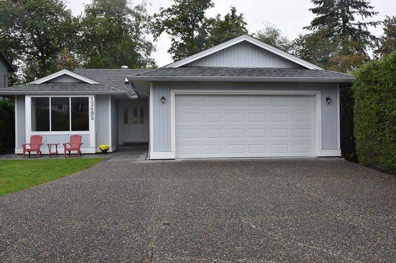 Welcome to Davison Subdivision!! One of Maple Ridge's most sought after neighbourhoods! Enjoy 1 level living at it's finest overlooking private GREENBELT! Spacious custom 3 bedroom rancher located close to schools, parks, transportation and all other amenities.Recently updated with new expensive custom patio and sidewalk design, paint, carpets, flooring and fixtures. Boasting plenty of cabinets, kitchen island, natural gas BBQ hookup, storage shed, 5 piece ensuite with separate shower, 3 skylights, sliding doors from family room and Master bedroom to yard.Enjoy morning coffee with a serene view of unobstructed greenery and nature from your large custom patio. Call today to view this Rare Gem!!  Open House Sunday, Oct 21st 1-3pm.
