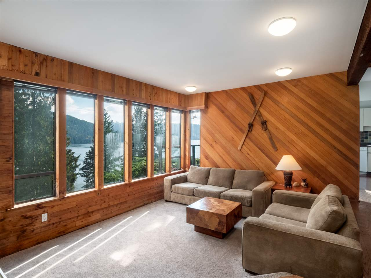 Wow! Here is a fantastic opportunity to secure a 4 bedroom home located in the quaint area of Deep Cove with amazing water views of Indian Arm. Located off a no-through road with nothing but peace and quiet as your neighbours. This home has 3 levels each with its own expansive deck with stunning views off to the water. The main floor features a large dining area, a sunken living room with a wood burning fireplace, a cute kitchen with access to an east facing deck for taking in the serene water views. Up a level you will find 3 large bedrooms, a play area and a recently updated bathroom. On the top floor you will find another bedroom,  large storage room, and a home office. Minutes to the Village and only steps to the water, parks and schools.