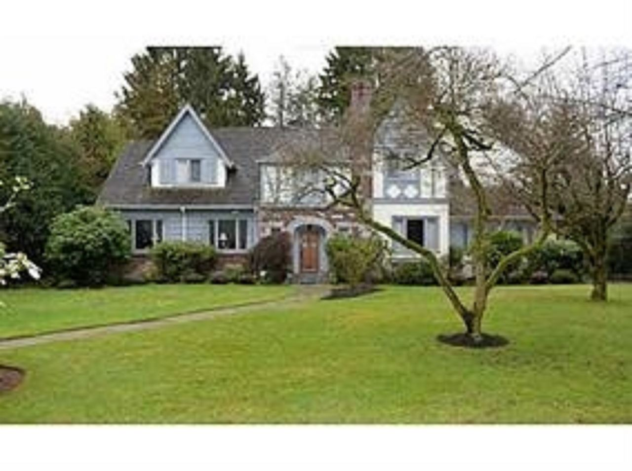 A rare opportunity to own this classic shaughnessy home  at beatiful  tree lined street . This pefect  south facing  park  like lot with  100'  frontage,  164 depth , private garden and back lane.   Inside & out with leaded windows, bordered oak hardwood floors, keystone entry, oak door & brick, stone, stucco & shingle exterior.  . Gracious  and spacious with entertainment sized living & dining rooms, sitting room & cozy wood paneled den/ office. Period kitchen with eating area. Large private patio/ deck off dining, steps down to fenced yard & mature gardens.  . 4 brms, 2 baths up. Finished recreation room & den in basementt  with  high ceilings & lots of storage.  Close  to York House. Shaughnessy element  School  and  Hamber  secondary school .  Quiet location perfect for redevelopment