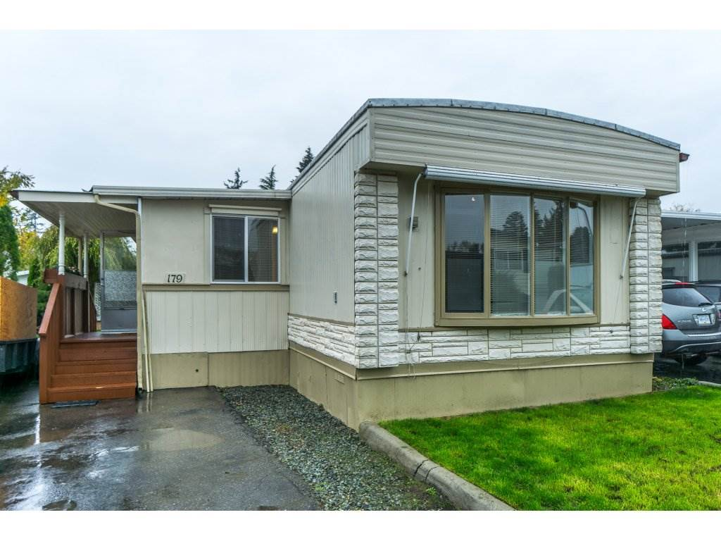 Friendly Langley Grove Estates - this 2 Bedroom 2 Bath home has a great location with excellent neighbors. Open plan - gas fireplace - large recreation room - a nice family home. Pad Rental only $717.57- 1 small pet - no age restrictions or rentals - Come and view your new home - and get ready to move in.