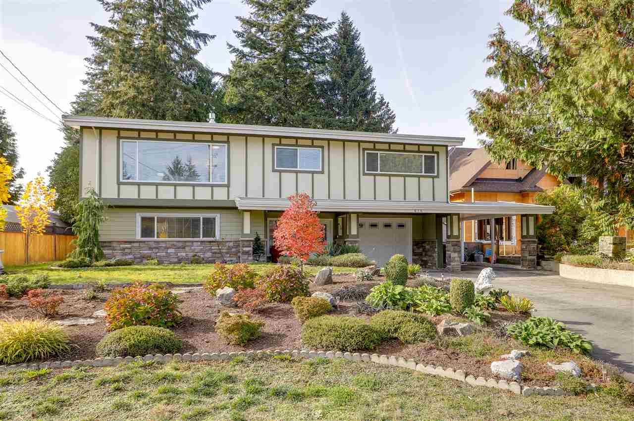 Established neighbourhood walkable to everything and minutes to Skytrain & Hwy 1.  Charming mid-century modern features with oak HW/walnut inlay floors, corner FP with slate hearth.  Spacious renovated main & SS kitchen w/banquette eating area and access to huge, level backyard w/dog run, 5 piece tiled main bath w/double basins, soaker tub and shower. New renovated basement with pot lights, furnace, hot water tank, all new wiring and raised ceiling.  Wood look vinyl flooring, gas FP, new luxury bath, large bedroom with WIC/den and laundry.  Easy suite with summer kitchen and separate entrance.  Newer windows, new insulation in 9 year roof, heat pump.  All appliances replaced last year, new fibreglass decking (gas outlet) & outside staircase replaced.  Single carport + single enclosed, insulated and drywalled garage w/pot lights and built in DOG WASH Station/gardners/handman!  This is a winner.