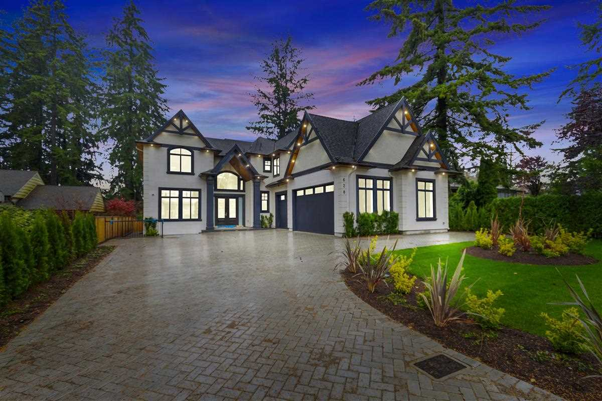 Masterfully Designed, Custom Built SMART Home w/Luxurious Interior Design & Meticulous Attn to Detail on huge 12,276sf lot, steps to COMO LAKE PARK. This 8 Bed/8 Bath home is host to Stylish Living Room w/Open Floorplan, fully opening to 346sf Covered Deck, Italian Marble FP & Dining Room. Grand Staircase w/Glass Railings, Extra High Ceilings, Gourmet Kitch w/Wok Kitch incl Bosch appls & 1 of 2 Lrg Master Bdrms w/Ensuite & Steam Shower completes the Main. Upper lvl has 4 generous bdrms incl Oversized Master w/Spa-like Ensuite, his & hers Walk-in Closets & Cozy Patio. All other rooms incl own Ensuites & Vaulted Ceilings. Lower lvl boasts an 800sf 2 Bdrm Legal Suite, Family Room, Bdrm,Den, Wet Bar & Wine Cellar. 3 Car Garage w/Elec Car Chrg Station,Radiant Heat,A/C,HRV & Back up Generator.