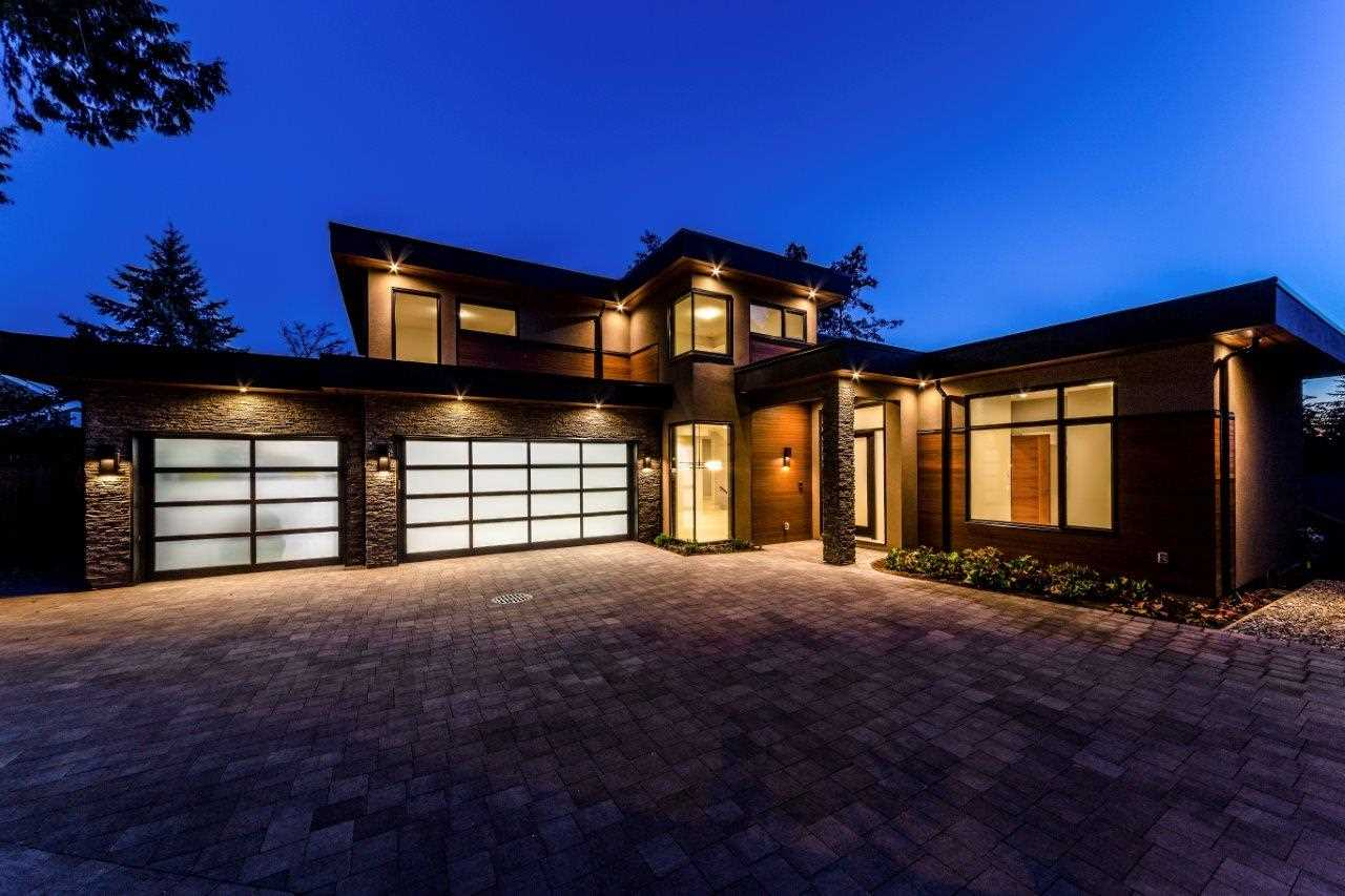 LARGE EXECUTIVE HOME (6657 SQ/FT Finished) on an OVERSIZED LOT (10,747SQ/FT) boasting a lovely CITY VIEW from the master bedroom and deck and a hard to find 3 CAR GARAGE COMPLETE WITH A CAR LIFT TO SUPPORT A 4rth CAR! This well thought out plan has a level driveway, walk out main floor from the kitchen family room area to the south facing flat backyard with built in BBQ area. High end finishing throughout includes in floor hot water radiant heating, air conditioning, a den on the main boasting a full en-suite so it can double as a guest room, high ceilings, 4 beds up all with their own full en-suites, a massive rec room down with an impressive media room, wine area, and a fully self contained 2 bedroom legal suite.