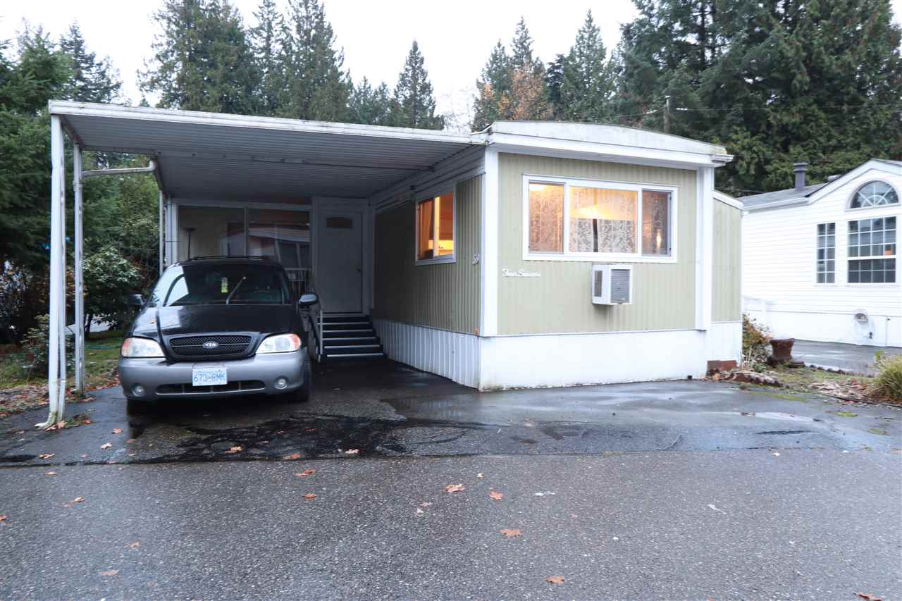 THREE Bedrooms TWO Bathrooms for UNDER $100,000 and Only $750/Mth Pad Rent.  Affordable Living in Langley's Best Kept Secret FOREST GREEN HOME PARK, located just Blocks from 200th and HWY 1.  Large Living/Dining/Kitchen with Tilt-Out.  Upgraded New Windows. The Large Master Bedroom has a WOOD STOVE for those Chilly Nights and 3 Piece Private Bath.  Covered and Winterized Sundeck, Covered Parking.  8x8 Garden Shed.  Back Porch with South Facing Sun.  End Corner Home.  Available for Christmas.