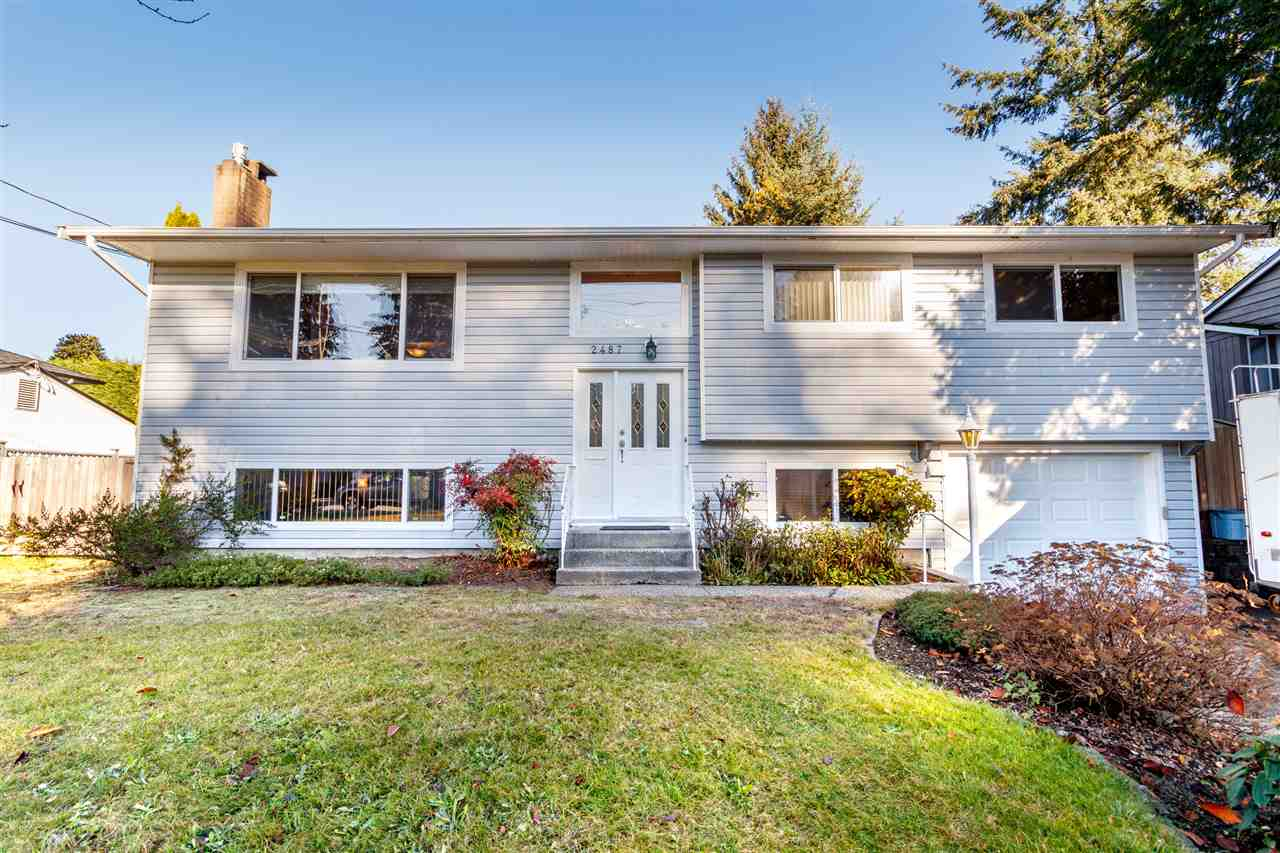 Well loved & maintained traditional family home on a glorious, level lot w/fenced private kid & gardener friendly backyard.  Walk to elementary school, as well as other levels of school, shopping, Mundy Park & bus stops.  SFU bus 1 block away. Beautiful refinished oak HW floors w/inlay, new doors, crown moldings, baseboards & casings, windows & roof replaced approx.12 yrs ago.  Classic, spacious living room w/picture window, gas FP in newer ledgestone setting & formal dining area.  Oak eat in kitchen w/lots of cabinets, huge pan drawers, newer counters & SS gas stove. Double basins in main bath & additional shower in lower floor bath.  Downstairs finished in laminate, set up for family fun- 4th full bed, plus 5th w/no closet plus family room w/heat efficient gas FP. A real bonus for handy people is a huge 27?1 x 11?6 concrete workshop (not included in livable floor area) w/outside access & permitted electrical sub panel.  Additional space in long garage w/newer door. Desirable, quiet neighborhood.