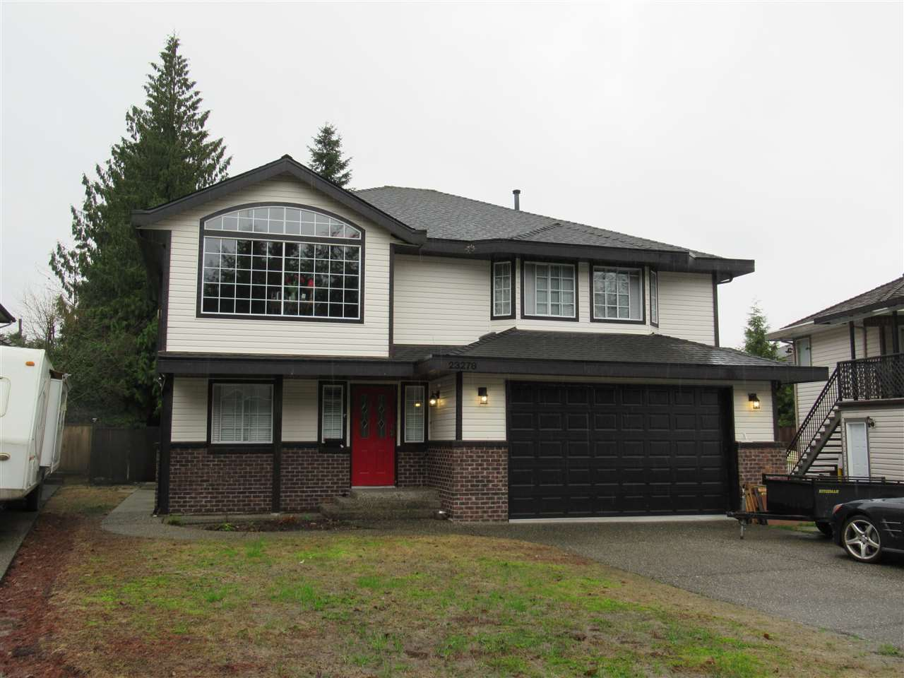 Beautiful family home on a quiet cul-de-sac. Basement entry home with a 1 bedroom ground level basement suite. 3 bedrooms up with 2 baths and a family room as well. Lovely large deck overlooking the oversized completely fenced in backyard. Kitchen is bright and spacious connected to the family room. Double car garage with room for RV parking as well. Nice views of Golden Ears from the large Living Room window. Home is 2,518 sq. ft. in size and the flat level lot is 7,170 sq. ft.