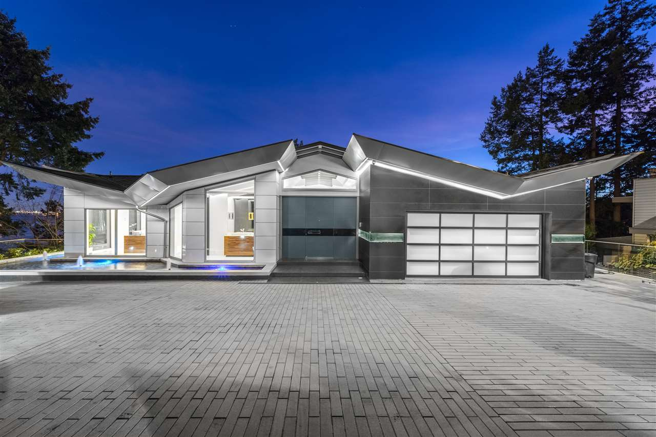 An architectural masterpiece boasting over 6,000sqft of living on +14,000sqft waterfront lot w/ breathtaking 270 degree views! This brand new home features jaw dropping details on all 3 lvls w/5 beds, 7 baths, double infinity edge pool, hot tub, sauna & top of the line design w/a glass elevator, Italian cabinetry, steel structure & +3000sqft outdoor space. Stunning panoramic views of city & water on main lvl & world class kitchen w/a massive island, wok kitchen w/full range of Gaggenau appliances, coffee maker, living & dining room & wine cellar. Lower lvl features 2 luxurious masters complete w/spa like ensuites & balcony access & 2 add.beds w/ ensuites. Relish in lower lvl activities ft. theatre room, full bar w/wine fridge, wine cellar, rec room & outdoor kitchen.