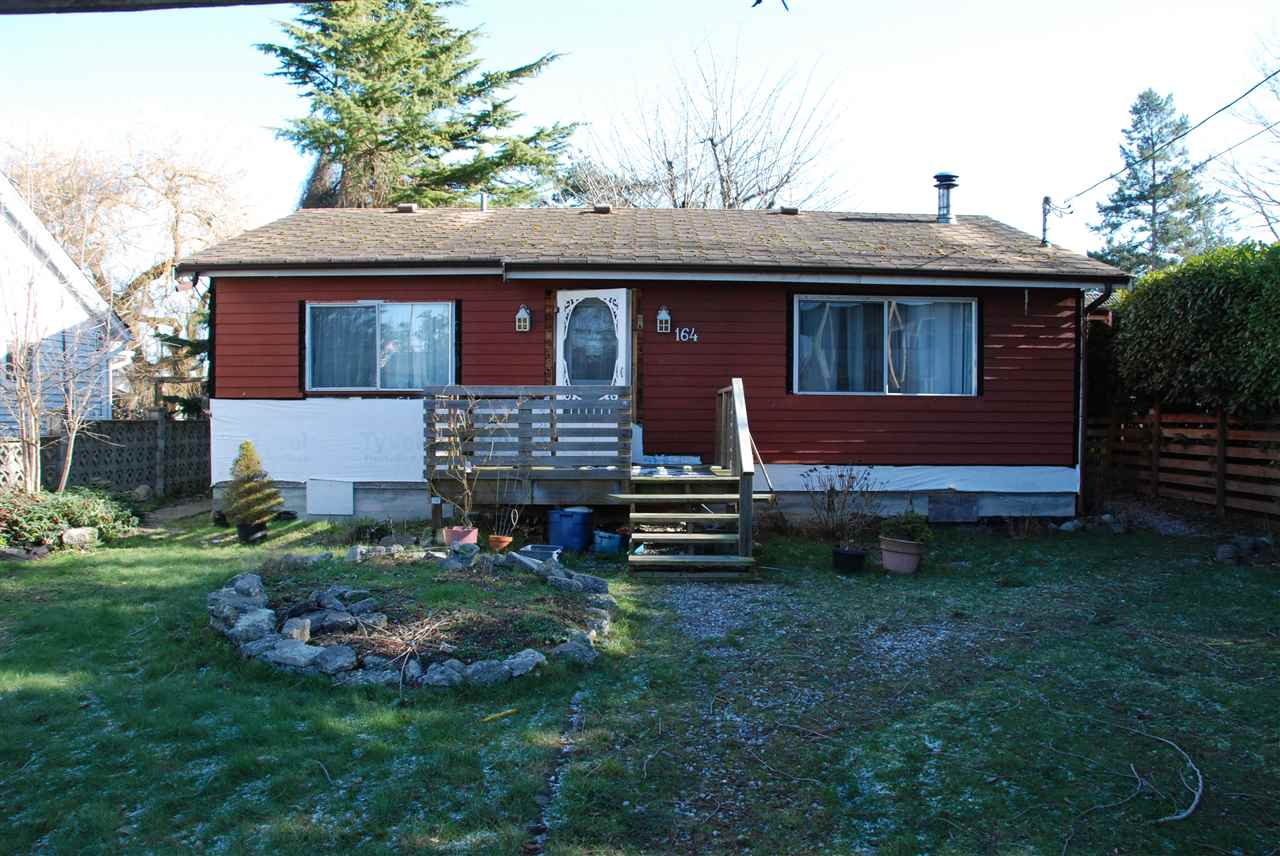 """Fantastic opportunity to build your dream home with lane access only steps from Boundary Bay Beach and boat launch. 7165 sq ft lot allows a build up to 2791 sq ft plus 452 sq ft garage. Great holding property while you make your building plans to live the dream in """"The Bay""""!"""