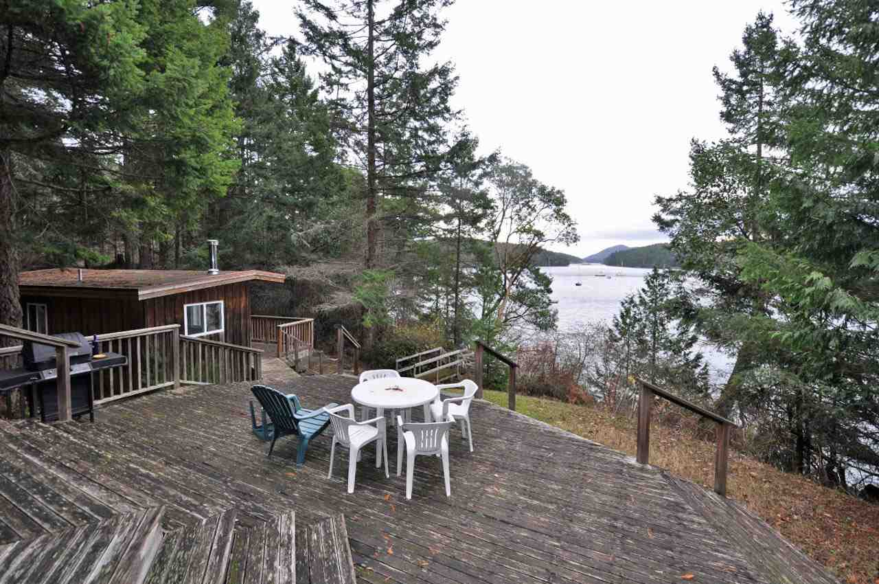 Private and nicely forested 1.55 acre south facing property overlooking Horton Bay on Mayne Island. Includes 1,729 sf 3 bedroom main home and 439 sf 1 bedroom guest cottage. The attractive main home has tasteful wood finishings throughout and features a beautiful river rock fireplace. French doors lead to a large deck with walkway down to boat shed and deck on the beach. This is the perfect Gulf lsland getaway, call to book your appointment to view today!