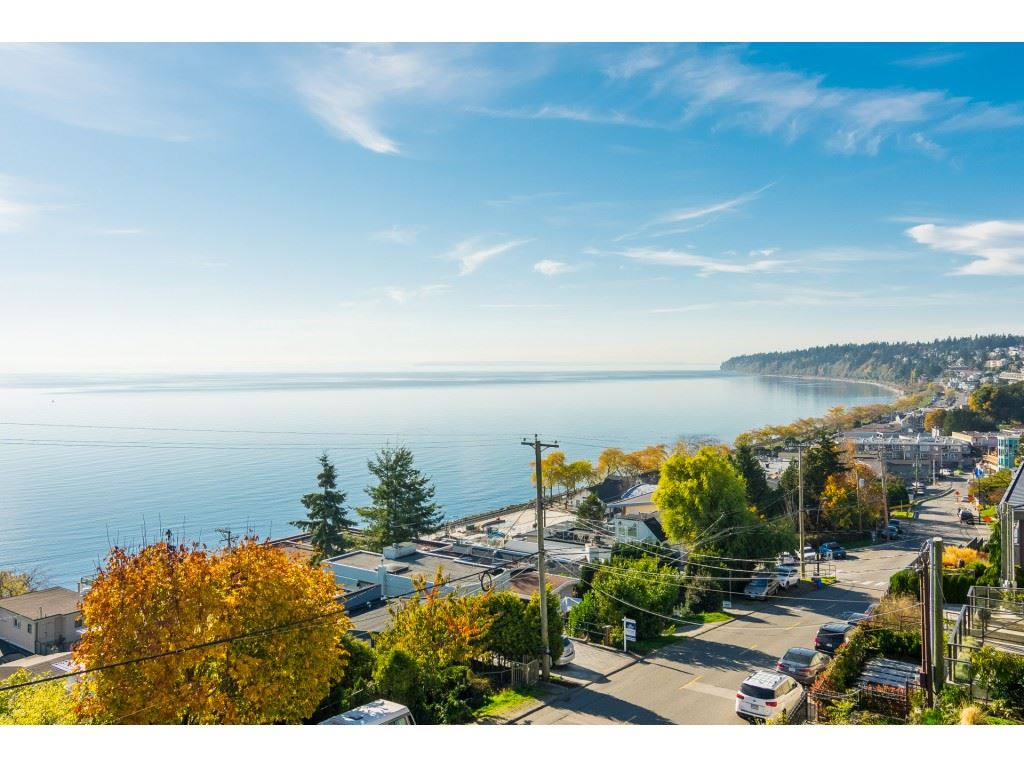 Ocean view completely renovated home. Rainscreened, new windows thru-out, hardwood floors thru-out. Main floor also has den with glass wall to take advantage of view. In-floor heating plus vane. Large skylights on top floor. Bsmt area possible 1 bdr suite with it's own deck & entrance. Parking for 5 vehicles. Pleasure to view.