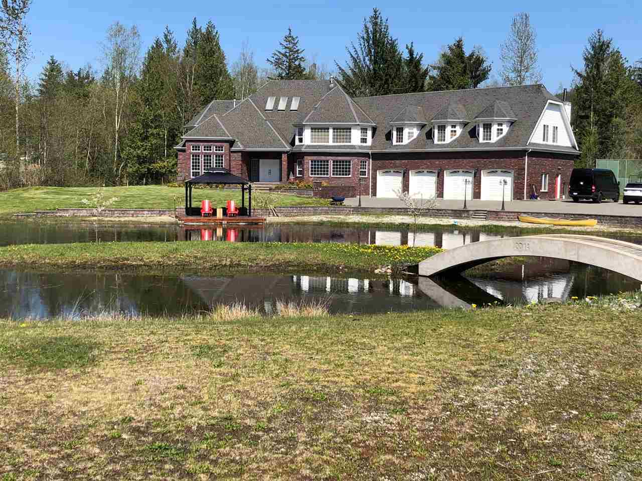 No words can fully describe this timeless classic designed home. Flat nearly 5 acres on top of the Sumas Mountain with over 6700SF of beautiful living space plus attached over-sized 4 car garage. All 5 bedrooms with ensuite bathrooms and huge walk-in closets. Entertainment sized Kitchen with built-in Thermador appliances. Huge man-made trout stocked lake even has white sand beach, fountain and concrete bridge to the little island. Almost every inch of interior is redone with high-end materials by master tradesmen. It just feels like staying in 5 star resort all year round. Helicopter pad, Tennis/Basket ball court, Automatic gate, Diesel backup generator. There is nothing else like it on Sumas Mountain.