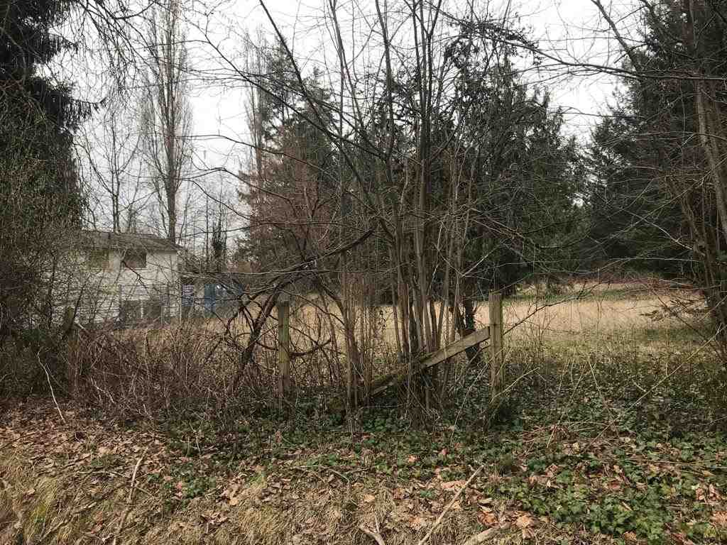The 2 acres no creek fully useable flat land.This property is holding so much of potential for future .You can build your dream home on one corner and wait until it gets subdivided . For further inquiries check with Municipality.