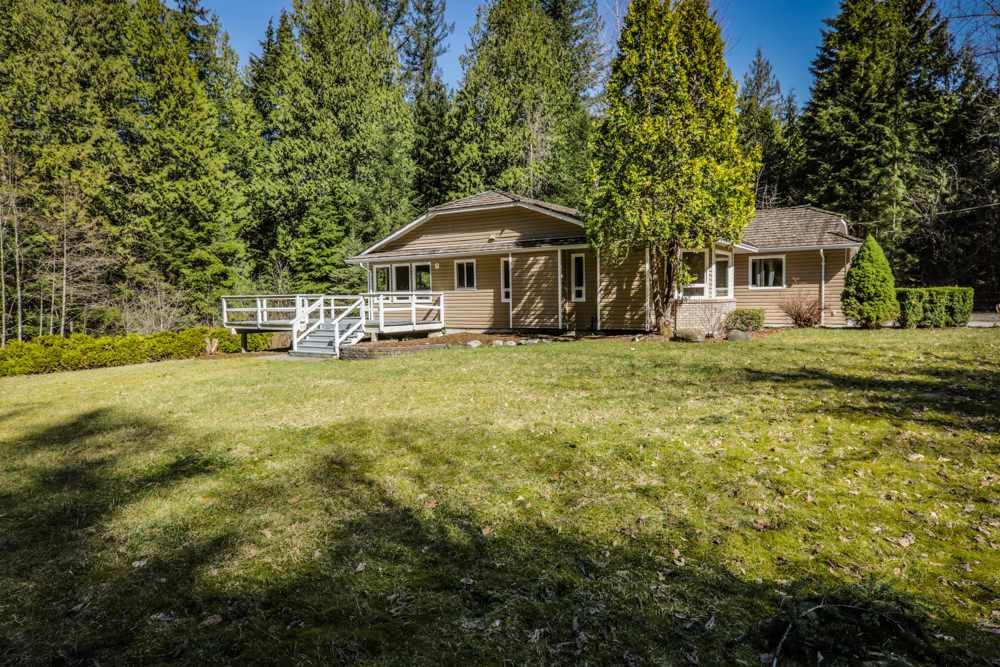Starter ranch on amazing flat 5 acre parcel. Privacy plus. Huge solid 4 bedroom 3 bathroom recently updated with open stainless/granite chef's kitchen. Tile & wood flooring throughout. Kitchen & dining room lead out through glass doors to a massive deck overlooking your ranch estate. Huge 38' x 20' shop/garage/barn awaits your ideas. Lots of space for horses, animals or agriculture. gated property. Insert your family name here: ______ ESTATE.