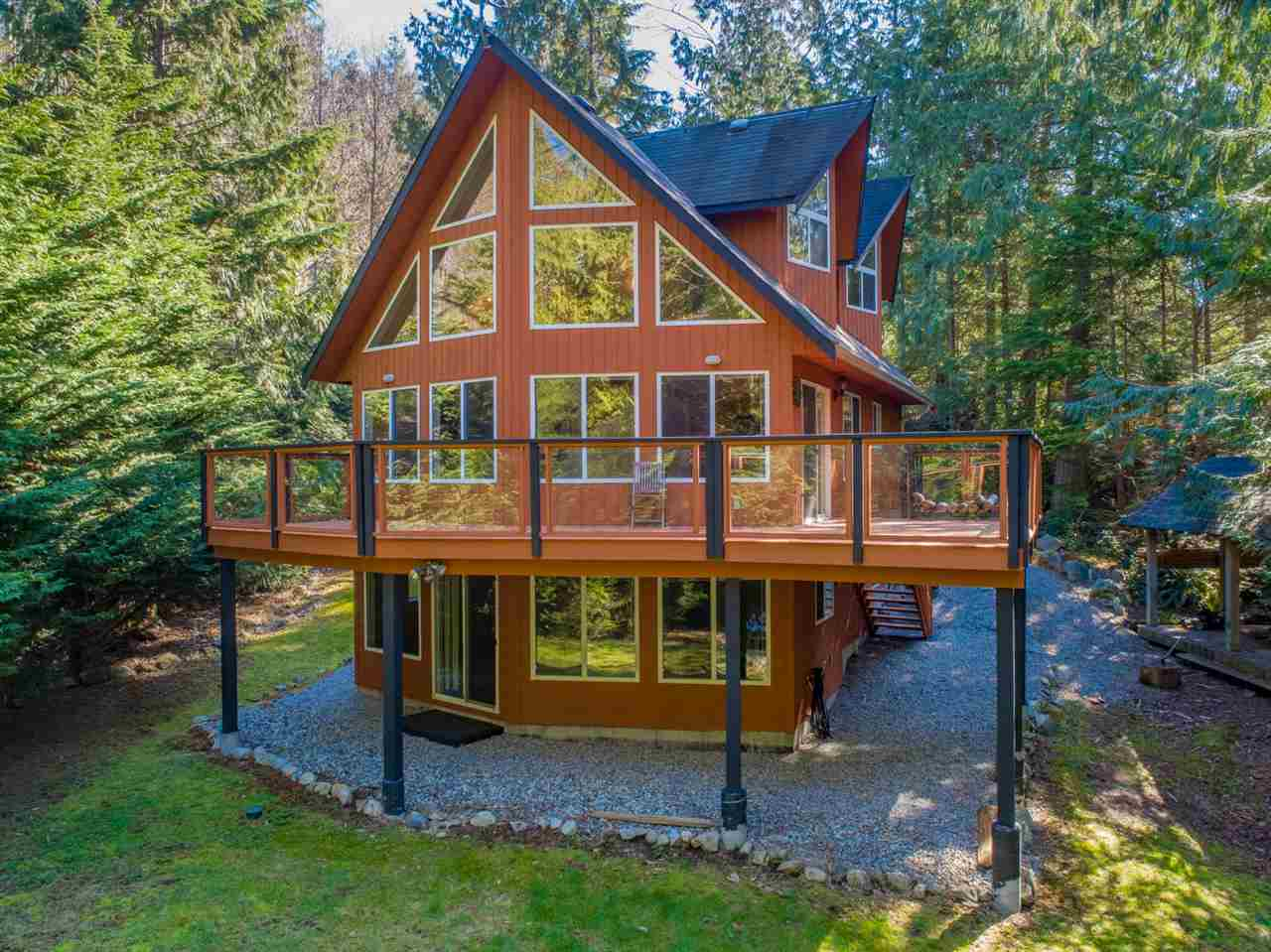 This home has been freshly painted/stained on all the exterior and decks & some interior making it move in ready condition. The home is nestled in mature trees including cedars giving that country setting location that everyone wishes to escape to. With 2/3 of an acre & a trout bearing creek this makes an ideallic setting yet only 20 minutes from Sechelt and all its amenities. If you like to go boating, Secret Cove is a mecca with its many different marinas. You have a quick boat ride to Thormanby and the sandy beaches or kayak around to Smugglers Cove. The upstairs of this home is a dedicated master suite. The main living is all about the kitchen dining and 2 storey vaulted ceiling of the living room & its faux rock fp. Downstairs has suite potential with a large rec room, bedroom & bath