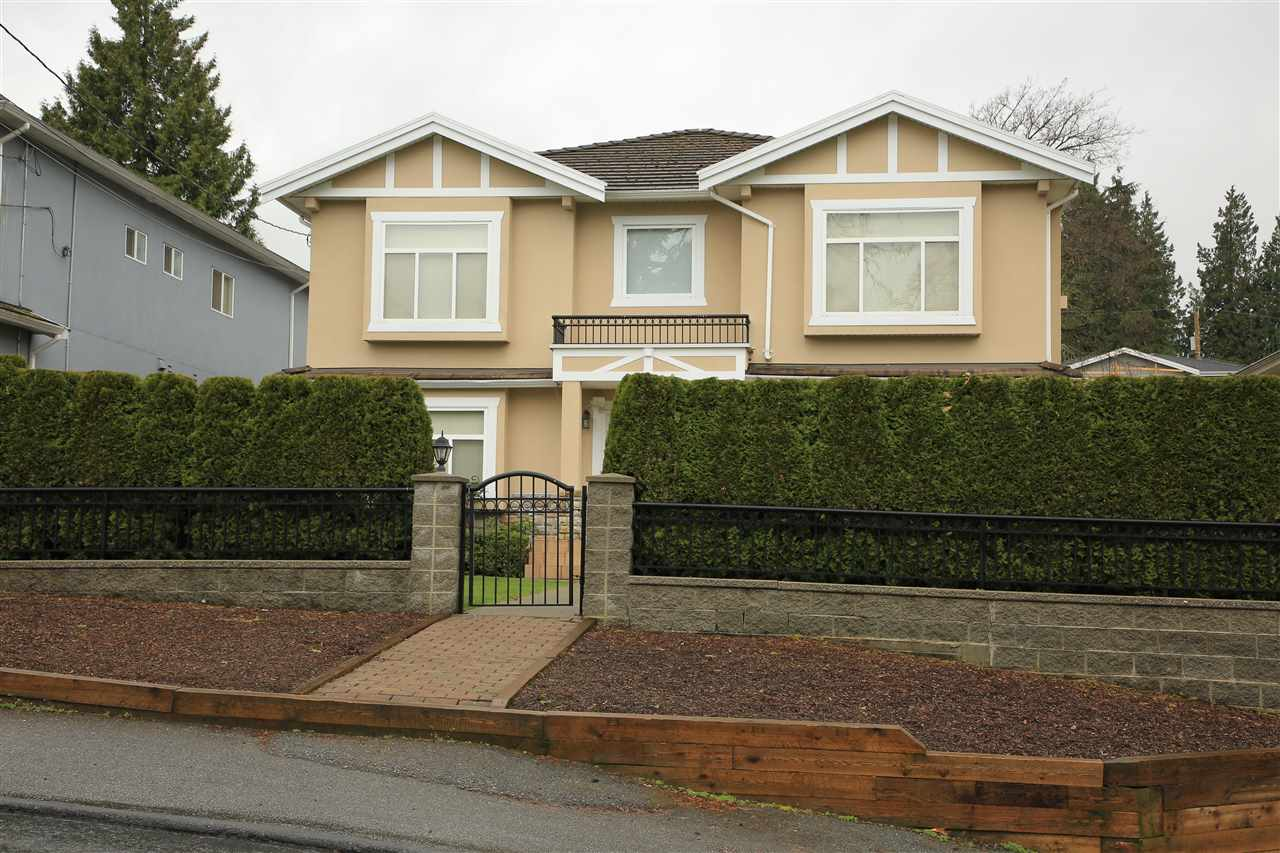 Central location, desirable Forest Glen.  50' x 151' big lot.  Custom 2 level home right across from Kisbey Park.  Functional floor plan with total 8 bedrooms, 4 up + 4 down & 5 full bathrooms.  Features open foyer with ceramic tiled floor & vaulted ceiling.  Granite counters, skylights, radiant heat, attached double garage, one kitchen below, 2 bedrooms & 1 bathroom on each side.  Fenced backyard with lots of open parking space.  Close to all amenities, School, Metrotown, Deer Lake, Public Transportation, Restaurant and more... Tenanted Basement.