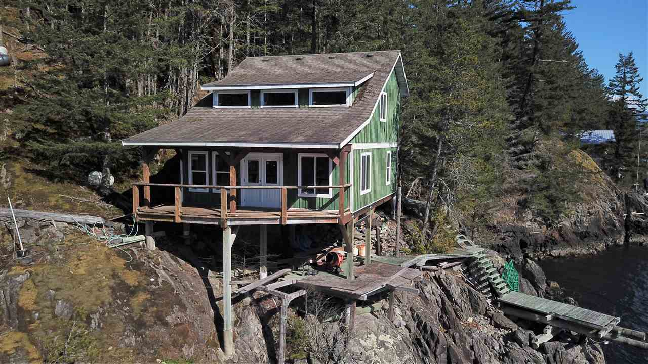 "Stunning 1.18 Acre Oceanfront Property located in ""Five Coves""on the Howe Sound. The private property is forested, and located right on the ocean, and next to the rocky shores. The 20 lot community also hosts a community dock and pebble beach. This cabin was constructed in 2007, and awaits a new owners design + finishing in the interior. The inside of cabin can be configured with kitchen/bath/bedroom and upstairs with two bedrooms. Access to his lot is boat access only - 15 minutes by boat from Porteau Cove and only 3/4 hour by boat from Horseshoe Bay."