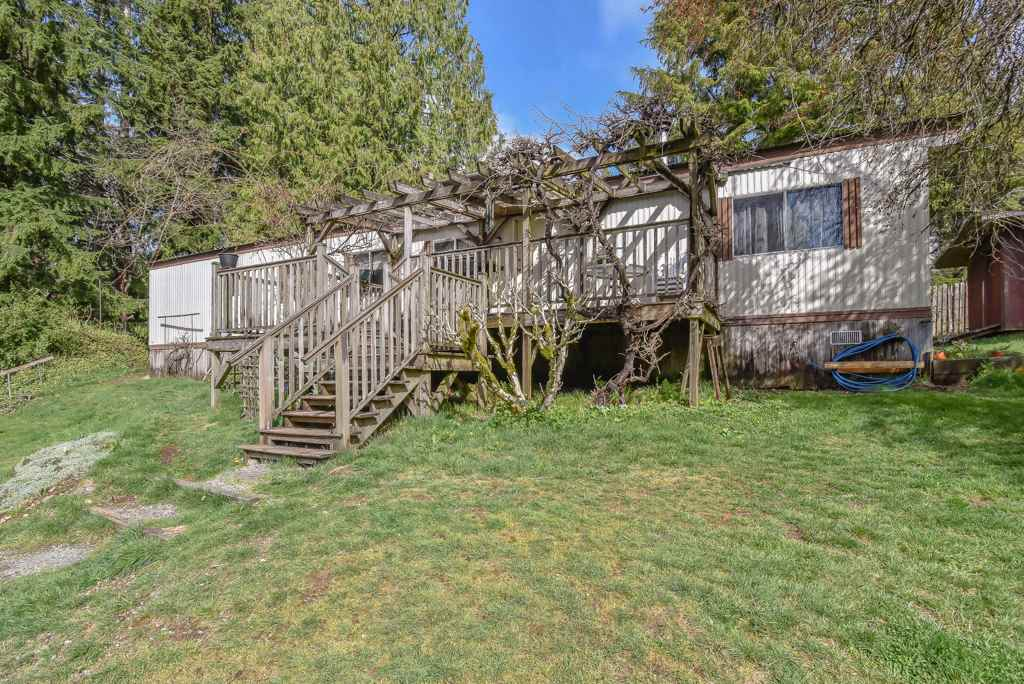 """Beautifully landscaped, with massive 338 feet frontage, peaceful and very private 3 acres """"estate"""" in Maple Ridge. The value is mostly in land as the mobile home is from 1982 but it is very solid and kept in good mechanical condition. The property features 3 bedrooms, one bath, cozy wood burning stove, large shop plus a double carport. This fantastic location in the heart of wilderness offer unlimited options and all privacy one could want! (No for sale sign on the property)"""