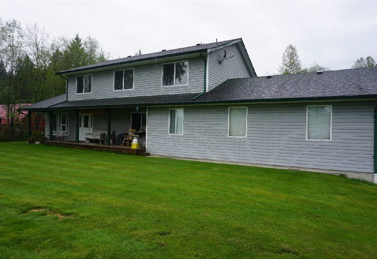 "Amazing 4,300 sqft home on 5.34 acres in the Silverdale development area. Man's ""Paradise"" a 70X40 double high shop with a 13""7 high door for your RV or big truck.  A 2 bedroom inlaw suite is above the shop. This has potential to be resold to a developer on a 3-4 year buy out with a great profit to you. This is a 1/2 interest listing .. we are selling 50% of the ownership and the other 50% is also available to buy."