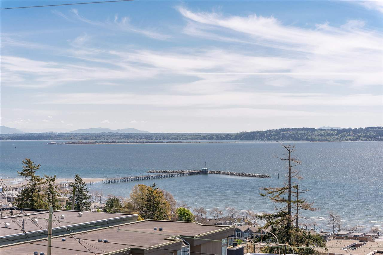 AMAZING OCEAN VIEWS from all 3 levels and just a few minutes walk to White Rock beach! Quality built home featuring 5 bedrooms and 4 full washrooms, 9' ceilings, hardwood floors and radiant floor heating. Boasting beautiful views from the gourmet kitchen made for your family gatherings. Come and see the oversized master bedroom with ensuite, walk in closet and stunning fireplace. The multiple large decks feature breathtaking views and are perfect for relaxing or entertaining guests. Updates in this home include hot water tank (2014), boiler (2014), roof & skylights (2012), exterior paint (2014), flooring & kitchen (2015) and bathrooms (2016). There is an incredible amount of storage available plus a 2 bedroom suite with full kitchen.  Open House June 22, 2019 from 12 PM - 2 PM!