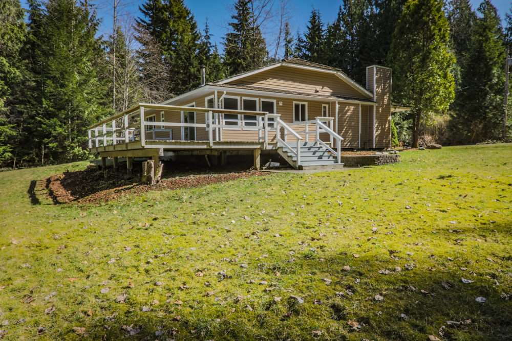 Starter ranch on amazing flat 5 acre parcel with drilled well. Privacy plus. Huge solid 4 bedroom 3 bathroom recently updated rancher with nice open stainless/granite chef's kitchen. Tile & wood flooring throughout. Kitchen & dining room lead out through glass doors to a massive deck overlooking your ranch estate. Huge 38' x 20' shop/garage. barn awaits your ideas. Lots of space for horses/animals or agriculture. Very comfortable gated & fenced acreage.