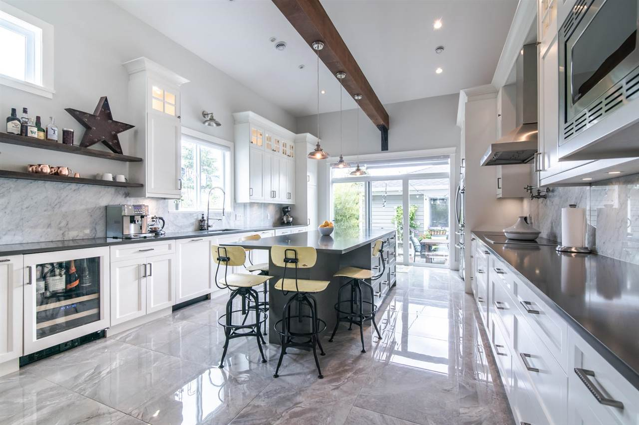 STUNNING CUSTOM BUILT home on a private CORNER lot, a short walk to Central Park & Skytrain! Attention to detail thruout inc soaring vaulted ceilings & beam in a chef?s dream kitchen. A true Entertainer's Delight w/a main floor that is washed in natural light all day & well connected to outdoor private space & lovingly planted gardens. Downstairs features a RARE 2 bdrm + den 2 bath LEGAL suite which could easily have one bdrm & bath for upstairs' use. Large, bright office on main floor with built in cabinetry. Acacia hardwood floors, glass railings, designer light fixtures, wok kitchen, infrared Sauna, raised organic vegetable gardens, roughed-in car charger in dbl garage, radiant in floor heat, A/C, HRV & back-up generator are just a few of the many features of this beautiful home.