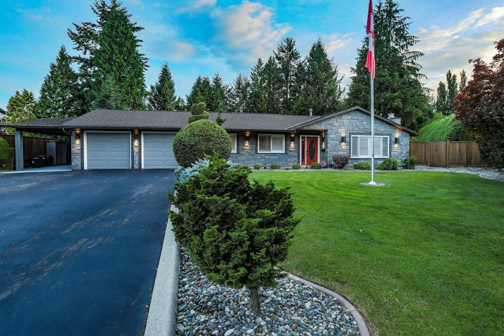 Private & gorgeous, a gem nestled in a quiet cul-de-sac & perfect for your family. Executive rancher has the WOW - a chef inspired kitchen, abundant contemporary 2-tone cabinets, quartz counters, ss high end appliances incl 2 built-in ovens, sleek engineered hardwood floors, speaker system throughout, 2 gas fp, 200 amp service, 50 yr shingle roof, heat pump/AC. Huge master bdrm - relax in your spa-like ensuite with in-floor heat. Step out to your 4 seasons patio sunroof w/infrared heaters, wet bar, built in gas BBQ - an Entertainers Dream. Lounge by your sparkling 38x18 inground pool w/remote control cover, surrounded by lush landscaping, inground irrigation & pondless waterfall...All of this on .56 acres. Close to schools, shopping, bike trails, canoeing, boating. Only 35 min to Vancouver