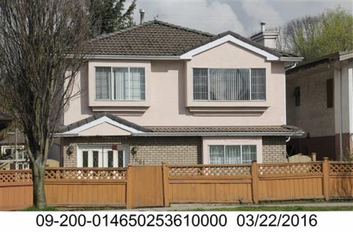 Location! Location! Just a stone throw from Safeway / Sky train. Vancouver special with two basement suites and back lane. The property falls in new Zoning for 6 story building (Check with City Hall). Great House to live with basements or  Rent and  see your Investment grow!!!