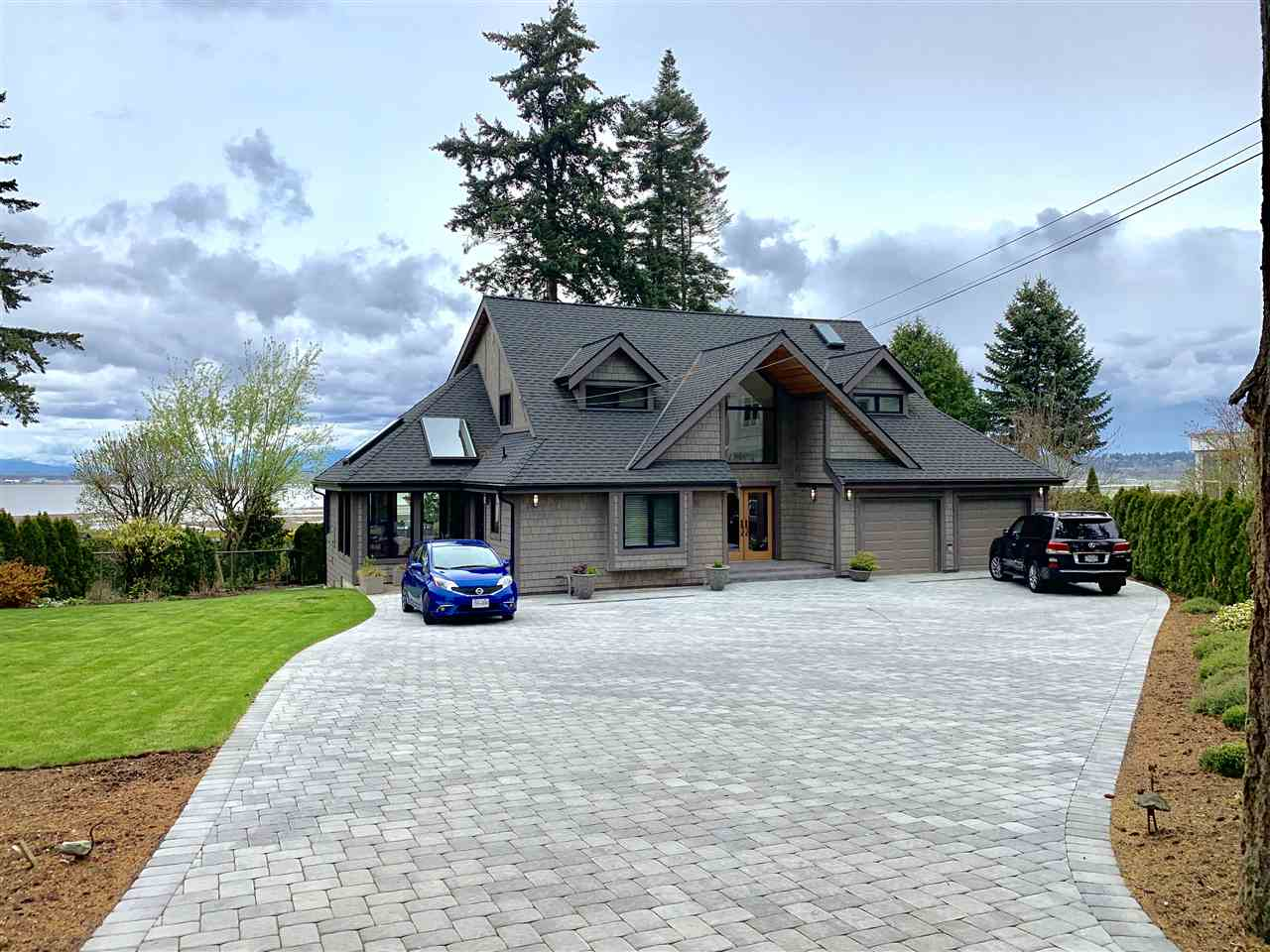 Water Access! - This beautiful home is set on one of the nicest Oceanfront lots in the White Rock/ South Surrey area. Full 180 degree ocean and mountain views from almost every room. Ovation Awards winner in 2016 for Best Exterior Renovation this home is sure not to disappoint. This exquisite home is set on a huge, private, gated water view/front lot with trail access to Nikomekl River. Enjoy sunsets almost every night from your amazing covered outdoor living space and viewing deck framed with 10 x 10 rough cut fir post and beam and frameless glass to maximize enjoyment. The interior has been updated with Gorgeous Solid Oak flooring, handcrafted Maple Kitchen cabinets, Loewen windows and doors. A five minute drive to popular Crescent Beach and five minutes to the highway.