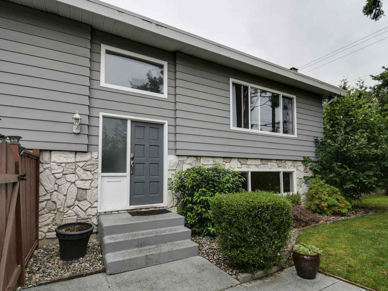 START THE CAR-INVESTOR ALERT! Excellent holding OR Investment property in White Rock! Renovated in 2012 this 2 storey basement home offers many options. Upper floor is 2 good sized bedrooms, main bath features new vanity, dbl sinks & slate flooring. The kitchen is fantastic for entertaining with a HUGE wrap around island, newer appliances, built in wine rack, lots of pull out drawers & storage. Full size dining room open to cozy living area w/wood fireplace. Above ground Lower floor also has a kitchen, built in computer desk, spacious living room, bdrm & 4 pc bath, lots of windows for a bright & cheery 1 bdrm suite. Great outdoor space, front yard, side yard  & AWESOME private deck.