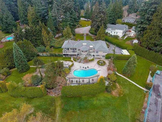 Unique hidden Pearl Estate with great investment and collection value of the 3.58 acres(155,881SF) land size at the best location, the best community in South Surrey White Rock. Within walking distance to the best public schools( Chantrelle Creek Elementary & Elgin Park Secondary),on the west side, the current two-level home with new roof installed in 2015 is surrounded by stanley-park like garden with a pool, a tennis court, a koid pond, a hot tug, a fountain, a fire site and a large and flat back yard where you can play golf. On the east side, an outbuilding stands with one bedroom suite and huge office rooms where a family business can be run there. Currently tenanted with good monthly rental income.You can't miss it this time!It must be sold soon!