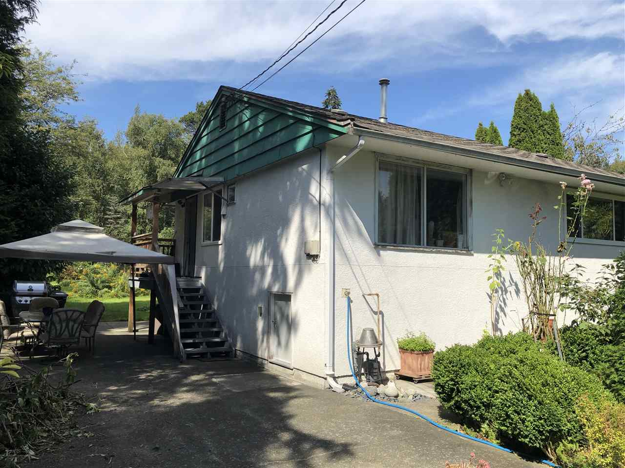 Great opportunity to build your dream home on a large 60 x 269 lot. Well maintained existing home. Home has 2 bedrooms and open living / dining / kitchen area. 1 full bathroom & laundry room. Natural gas forced air heat with hot water on demand. 3' concrete crawl space under the house great for storage. Close to skytrain and Marine Drive for commuting. Call your realtor today