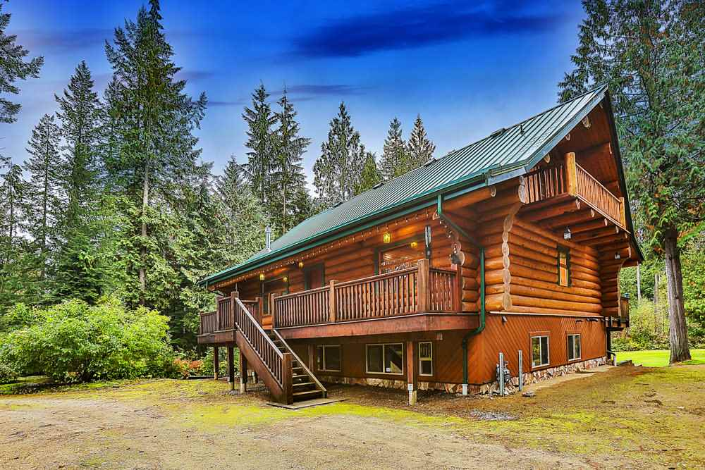 """LOVE AT FIRST SIGHT! This spectacular """"Artisan"""" hand hewn Spruce LOG HOME will absolutely win your heart! Tucked away at the end of a quiet no thru street on the West side of mission, you will find this piece of paradise. Drive down the circular drive framed by majestic Douglas Firs, and enter into the Spotless Custom Built home with open concept and soaring vaulted ceilings. Enjoy the quiet of the country yet only 7 minutes to town. The main floor is an entertainers dream with huge island kitchen, living/dining room combo with gas potbelly fireplace. Large Master Bedroom on main floor, with adjoing full 4 piece bath complete with Clawfoot Tub. Full loft currently used as Master Bedroomcomplete with martini deck ovelooking manicured grounds. 3 More large bedrooms in basement. 2.9 Acre LOT"""