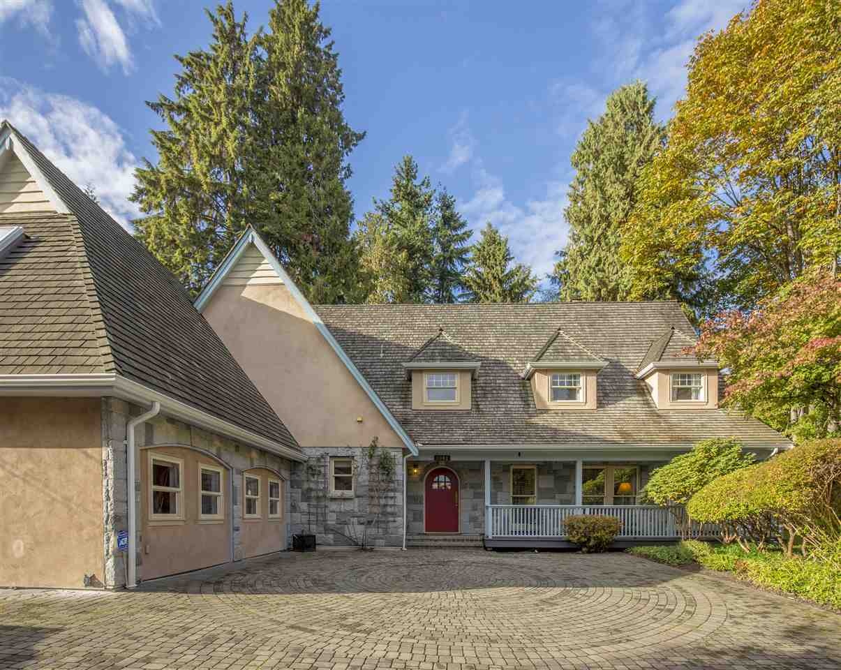 This is a beautiful English manor house located in the prestigious and sought-after Ambleside neighborhood. This stunning custom-built home is situated on an extraordinary 25,600 sqft lot with a wide cobblestone driveway and a private English garden. This two-story home of nearly 5,000 sqft features 4 spacious bedrooms and a guest suite with a separate entrance. The gourmet kitchen faces the country landscape. The unique garden greenhouse is the perfect place for relaxation and enjoying nature. The main floor also includes an office with a sports and entertainment room. The exterior of the house is inlaid with granite, making the whole building beautiful and unique. Open House Sat, 1:00pm to 4:00pm, Dec 7.