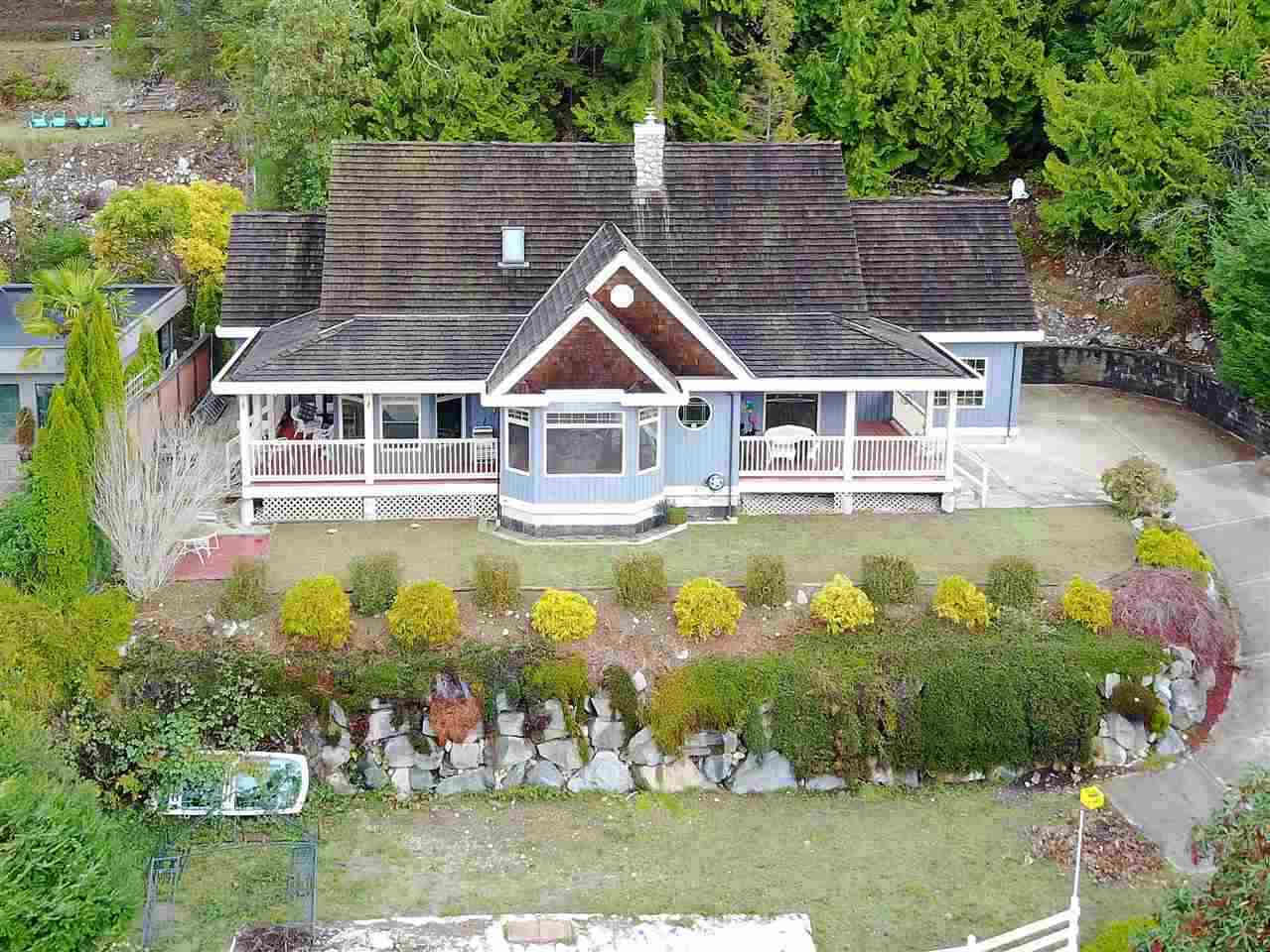 This tasteful, sun-drenched 3 bedroom rancher offers vista views of Hospital Bay and Pender Harbour and easy access to marinas, general store, restaurants, fresh water lakes and year round golf. Perfect for a summer retreat or retirement dream come true! Features include a spacious master suite with walk-in-closet and 5 piece bath, formal dining room, gourmet kitchen and a flexible finished bonus room upstairs. Outside you'll find a covered veranda, a roomy two car garage and additional terraced parking for RV or boat. Call today to arrange a private tour of this special Garden Bay home.