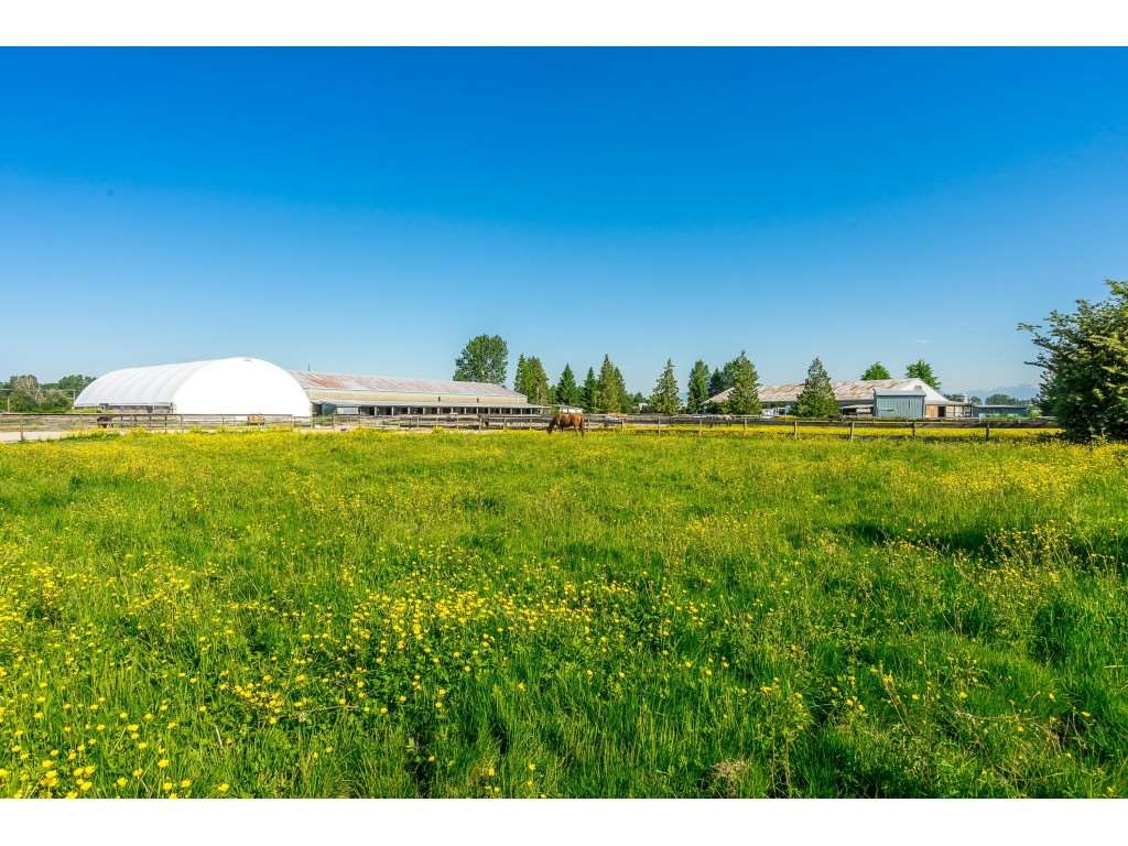 Opportunity knocks! Over 21 Acres nestled on one of the most desirable streets in Ladner! Exceptional equestrian facility suitable for all disciplines. Features include: Indoor Arena with second floor office and viewing area, Covered Arena, Outdoor Arena, Work Shop & Clubhouse Facilities. 4 barns for horse stabling as well as turn out paddocks. Private grass Grand Prix ring and training track. Wonderful opportunity to build your dream home on a private, estate property with mountain views or run your successful agribusiness! This property has unique I1 Zoning. Close to all amenities, transit, Hwy 99, YVR & Vancouver. ALR land.
