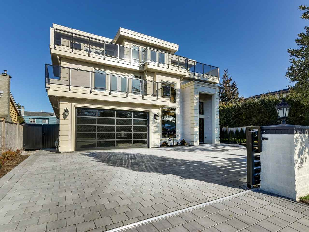 RARE!! This Contemporary 3 level home of 4895 sqft is located steps to Richmond Dyke. Spectacular OCEAN views from this truly Magnificent Luxury Family Residence situated on quiet end of the street. This exceptional Modern home of 6 bedrooms with 3 Master Bedrooms on 2nd & 3rd floor, 8 washrms, 2 Media Rms & Den offers a Stunning Open design with Spacious rooms, Large windows with WATER & Mountain View from the FOUR Large Front & Back Decks. GOURMET Kitchen & large WOK Kitchen too. Top of the Line Stainless Steel appliances. A/C, HRV & Hot water Radiant heating on all 3 floors. Luxury features including Security System with 6 HD Night Vision, Control-4 system with Integrated Lighting, Heating, Music & Garage Door. 2-5-10 New Home Warranty. Schools: Dixon Elementary and Hugh Boyd Secondary